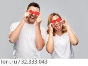 Купить «happy couple with red hearts instead of eyes», фото № 32333043, снято 6 октября 2019 г. (c) Syda Productions / Фотобанк Лори