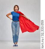Купить «happy woman in red superhero cape», фото № 32333059, снято 30 сентября 2019 г. (c) Syda Productions / Фотобанк Лори
