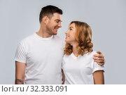 Купить «portrait of happy couple in white t-shirts», фото № 32333091, снято 6 октября 2019 г. (c) Syda Productions / Фотобанк Лори