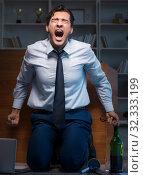 Купить «Stressed businessman working overtime in depression», фото № 32333199, снято 14 октября 2017 г. (c) Elnur / Фотобанк Лори
