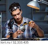 Купить «Computer repair man cleaning dust with brush», фото № 32333435, снято 11 августа 2017 г. (c) Elnur / Фотобанк Лори