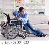 Купить «Young student on wheelchair in disability concept», фото № 32334023, снято 6 апреля 2017 г. (c) Elnur / Фотобанк Лори