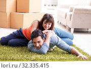 Купить «Young family moving to new house after final payment», фото № 32335415, снято 6 декабря 2017 г. (c) Elnur / Фотобанк Лори
