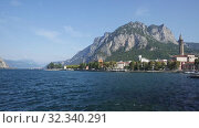 Купить «Picturesque view of small city of Lecco on shore of Lake Como on background of San Martino mountain on summer day, Italy», видеоролик № 32340291, снято 18 ноября 2019 г. (c) Яков Филимонов / Фотобанк Лори