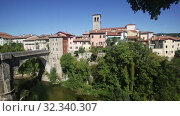 Купить «View of historic centre of Cividale del Friuli with medieval stone Devil Bridge (Ponte del Diavolo) over Natisone river, Italy», видеоролик № 32340307, снято 5 декабря 2019 г. (c) Яков Филимонов / Фотобанк Лори