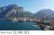 Купить «Picturesque view of small city of Lecco on shore of Lake Como on background of San Martino mountain on summer day, Italy», видеоролик № 32340323, снято 1 сентября 2019 г. (c) Яков Филимонов / Фотобанк Лори
