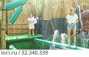Купить «Obstacle course over the water - fun adventure in an amusement park», видеоролик № 32340339, снято 29 июня 2020 г. (c) Яков Филимонов / Фотобанк Лори
