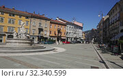 Купить «View of central square of Gorizia Piazza della Vittoria (Victory Square) with Neptune Fountain at sunny day, Italy», видеоролик № 32340599, снято 3 сентября 2019 г. (c) Яков Филимонов / Фотобанк Лори