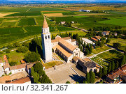 Купить «Aerial view of Aquileia with Basilica di Santa Maria Assunta», фото № 32341267, снято 4 сентября 2019 г. (c) Яков Филимонов / Фотобанк Лори