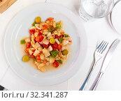 Seafood salad from slices of cod and vegetables. Стоковое фото, фотограф Яков Филимонов / Фотобанк Лори