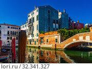 Купить «View of canals and cityscape with colorful buildings in Venice», фото № 32341327, снято 5 сентября 2019 г. (c) Яков Филимонов / Фотобанк Лори