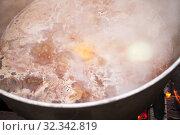Купить «Boiling hot broth with beef», фото № 32342819, снято 23 сентября 2019 г. (c) EugeneSergeev / Фотобанк Лори