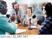 Купить «Glad adult presenters of different nationalities», фото № 32347167, снято 16 марта 2019 г. (c) Яков Филимонов / Фотобанк Лори