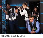 Купить «men and women co-workers having corporate entertainment», фото № 32347243, снято 4 апреля 2019 г. (c) Яков Филимонов / Фотобанк Лори
