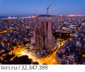 Купить «Barcelona, Spain - June 13, 2019: View from dorne of the famous Spanish landmark - temple Sagrada familia», фото № 32347399, снято 13 июня 2019 г. (c) Яков Филимонов / Фотобанк Лори