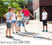 Купить «Happy children jumping game by rubber band and laughing», фото № 32349559, снято 6 декабря 2019 г. (c) Яков Филимонов / Фотобанк Лори