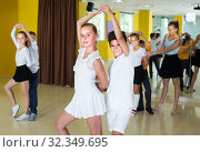 Купить «Positive kids are dancing rock-n-roll in pairs», фото № 32349695, снято 13 июля 2017 г. (c) Яков Филимонов / Фотобанк Лори