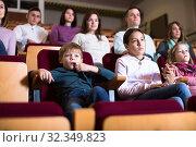 Купить «People audience attending movie night», фото № 32349823, снято 3 декабря 2016 г. (c) Яков Филимонов / Фотобанк Лори