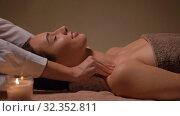 Купить «woman having face and head massage at spa», видеоролик № 32352811, снято 19 октября 2019 г. (c) Syda Productions / Фотобанк Лори
