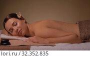 Купить «young woman lying at spa or massage parlor», видеоролик № 32352835, снято 19 октября 2019 г. (c) Syda Productions / Фотобанк Лори
