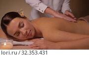 Купить «close up of woman having back massage at spa», видеоролик № 32353431, снято 19 октября 2019 г. (c) Syda Productions / Фотобанк Лори