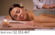 Купить «woman and cosmetologist applying clay mask in spa», видеоролик № 32353467, снято 19 октября 2019 г. (c) Syda Productions / Фотобанк Лори