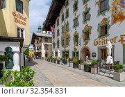 Купить «View of colourful architecture on Speckbackerstrassa in St. Johann in Tirol, Austrian Tyrol, Austria, Europe», фото № 32354831, снято 10 июня 2019 г. (c) age Fotostock / Фотобанк Лори