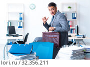 Купить «Businessman with heavy paperwork workload», фото № 32356211, снято 26 июня 2019 г. (c) Elnur / Фотобанк Лори