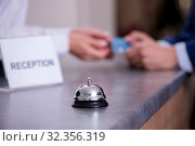 Hotel reception bell at the counter. Стоковое фото, фотограф Elnur / Фотобанк Лори