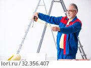 Купить «Old contractor doing renovation at home», фото № 32356407, снято 3 июня 2019 г. (c) Elnur / Фотобанк Лори