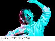 Купить «woman in headphones listening to music and dancing», фото № 32357159, снято 30 сентября 2019 г. (c) Syda Productions / Фотобанк Лори