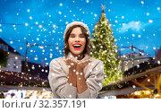 Купить «woman in hat sending air kiss at christmas market», фото № 32357191, снято 30 сентября 2019 г. (c) Syda Productions / Фотобанк Лори