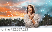 Купить «woman in hat and sweater over winter forest», фото № 32357283, снято 30 сентября 2019 г. (c) Syda Productions / Фотобанк Лори