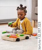 Купить «african baby girl playing with toy blocks at home», фото № 32357323, снято 29 сентября 2019 г. (c) Syda Productions / Фотобанк Лори