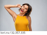 Купить «happy smiling young woman showing peace hand sign», фото № 32357335, снято 30 сентября 2019 г. (c) Syda Productions / Фотобанк Лори