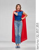 Купить «happy woman in superhero cape showing thumbs up», фото № 32357351, снято 30 сентября 2019 г. (c) Syda Productions / Фотобанк Лори
