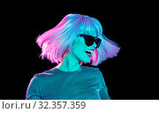 Купить «happy woman in pink wig and sunglasses dancing», фото № 32357359, снято 30 сентября 2019 г. (c) Syda Productions / Фотобанк Лори