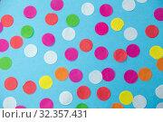 Купить «colorful confetti decoration on blue background», фото № 32357431, снято 11 декабря 2018 г. (c) Syda Productions / Фотобанк Лори