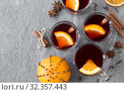 Купить «hot mulled wine, orange slices, raisins and spices», фото № 32357443, снято 4 октября 2018 г. (c) Syda Productions / Фотобанк Лори