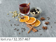 Купить «hot mulled wine, orange slices, raisins and spices», фото № 32357467, снято 4 октября 2018 г. (c) Syda Productions / Фотобанк Лори