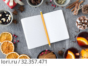 Купить «notebook, pencil and hot mulled wine on christmas», фото № 32357471, снято 4 октября 2018 г. (c) Syda Productions / Фотобанк Лори