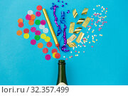Купить «champagne bottle with birthday party props on blue», фото № 32357499, снято 11 декабря 2018 г. (c) Syda Productions / Фотобанк Лори