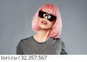 Купить «happy woman in pink wig and black sunglasses», фото № 32357567, снято 30 сентября 2019 г. (c) Syda Productions / Фотобанк Лори