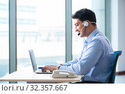 Male call-center operator in business concept. Стоковое фото, фотограф Elnur / Фотобанк Лори