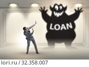 Купить «Businessman in debt and loan concept», фото № 32358007, снято 21 января 2020 г. (c) Elnur / Фотобанк Лори