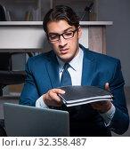 Купить «Businessman working overtime long hours late in office», фото № 32358487, снято 9 октября 2017 г. (c) Elnur / Фотобанк Лори