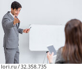 Купить «Business presentation in the office with man and woman», фото № 32358735, снято 7 августа 2017 г. (c) Elnur / Фотобанк Лори