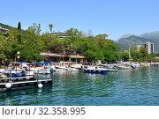 Купить «Budva, Montenegro - Jone 13.2019. A row of yachts on pier at the Old Town», фото № 32358995, снято 13 июня 2019 г. (c) Володина Ольга / Фотобанк Лори