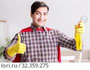Купить «The super hero cleaner doing housework», фото № 32359275, снято 22 декабря 2016 г. (c) Elnur / Фотобанк Лори