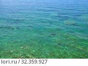Купить «Beautiful water in shallow water in Mediterranean Sea near Montenegro», фото № 32359927, снято 13 июня 2019 г. (c) Володина Ольга / Фотобанк Лори